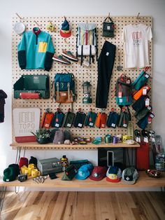 "topo-designs: ""Topo Designs Store Fort Collins, Colorado "" Maybe I should have a pegboard at home to display my carry… Hmmm… Clothing Store Displays, Retail Store Design, Retail Stores, Outdoor Store, Surf Shop, Colorado, House Design, Decoration, Shopping"