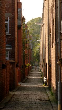 Back alley by old bus depot in Moss Side Manchester