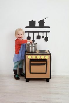 Play kitchens are imaginative and fun spaces for kids to cook up all sorts of pretend food. Customize your own from upcycled furniture or even dressed-up cardboard boxes with these fun DIY project ideas! Cardboard Kitchen, Cardboard Play, Cardboard Crafts, Diy Kids Kitchen, Toy Kitchen, Kitchen Ideas, Kitchen Post, Play Kitchens, Carton Diy