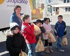 Ansonia pupils learn art of giving as they donate to food bank