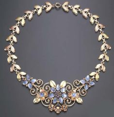 AN ELEGANT RETRO MOONSTONE, SAPPHIRE AND BICOLORED GOLD NECKLACE, BY TIFFANY & CO. circa 1950,