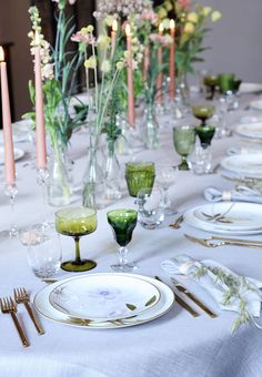 Gorgeous spring table setting with place cards as napkin rings.