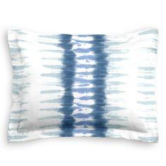 For a beach vibe try the Aqua Blue Shibori Stripe Sham from Loom Decor!