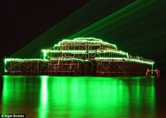 Green lasers bring the West Pier to life for Chinese New Year.