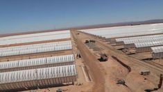 Should we solar panel the Sahara desert? - BBC News | Photo depicts rows solar panels at the Ouarzazate plant in Morocco