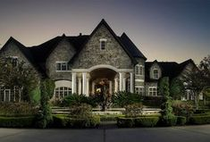 Traditional Exterior of Home with Fountain, exterior tile floors, Pathway, exterior stone floors