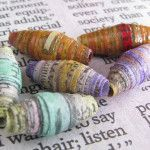 How to brighten up newspaper beads with watercolor
