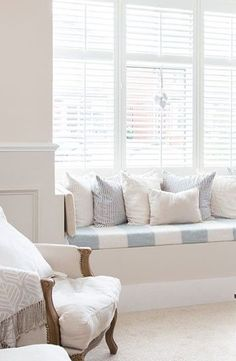 pale blue and white window seat