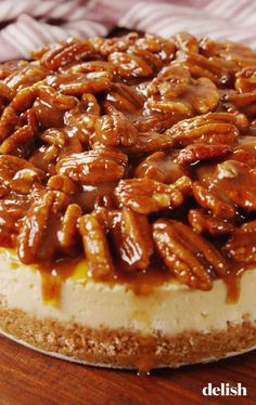 Pecan Pie Cheesecake Will Make You Wish It Was Thanksgiving TOMORROW--Delish. NOTE: A lot of time and effort could be saved by using a commercial cheesecake and just making the pecan topping to serve with it! Köstliche Desserts, Delicious Desserts, Dessert Recipes, Plated Desserts, Dinner Recipes, Pecan Pies, Apple Pies, Pecan Pie Cheesecake, Thanksgiving Desserts Easy