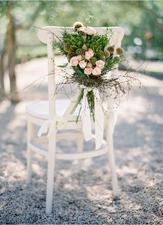 Wedding decoration on chairs.