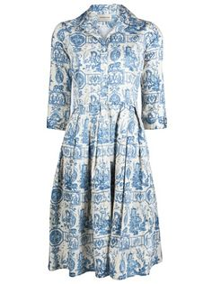 Audrey french toile dress in indigo and white from Samantha Sung. This cotton-stretch shirt dress features a collar with button down placket, three-quarter length sleeves with button cuffs, and full pleated skirt with side pockets.