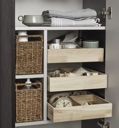 New Luna tall unit with functional wooden trays and wickerwork baskets.