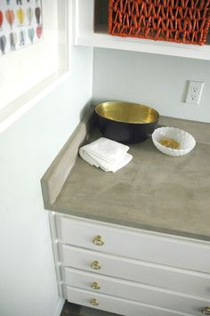 DIY Concrete Countertops, from Little Green Notebook. Maybe I should use this technique on my kitchen floors...
