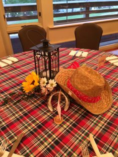 Centerpieces. Western, hoedown theme party. Sunflowers, lanterns, cowboy hats.