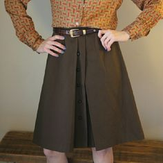 "Zara Brownie Front Pleat Skirt Girl scout brownie all grown up. Cute Zara woman skirt. Size small Button front. Lined. Sturdy fabric Zara Woman. Made in Spain. Estimated fit s/m. Waist up to 27"". Length 25"". Nice modest length. A few tiny snags and very minor fading/discoloration in fabric. Not noticeable. Yes, needs an iron. My steamer is out temporarily. :( Belt shown is not included. Listing is for skirt only. No trades. No pp Zara Skirts A-Line or Full"