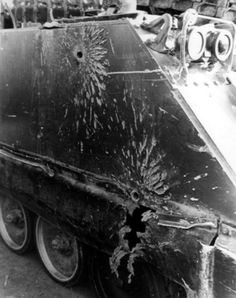 The side of an M113 APC after being hit by rounds from a Viet Cong 57mm recoilless rifle.