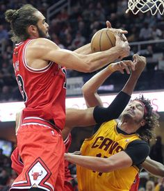 Chicago Bulls Joakim Noah grabs a rebound from Cleveland Cavaliers Anderson Varejao in th fourth quarter January 21, 2014 at Quicken Loans Arena. The Bulls went on to win the game, 98-87. (John Kuntz / The Plain Dealer)  |  http://www.cleveland.com/cavs/index.ssf/2014/01/cleveland_cavaliers_horrible_o.html