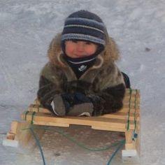 Inuk boy wearing sealskin, photo by Noodloo Peter