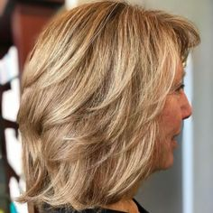 Mid Length Cut with Feathered Layers If you want to be a 60 year old woman that looks a full decade younger, consider a medium length feathered and slightly wavy haircut. The rich honey blonde hair color helps to bring out the natural ruddiness of your Medium Hair Cuts, Short Hair Cuts, Medium Hair Styles, Curly Hair Styles, Medium Curly, Long Curly, Over 60 Hairstyles, Older Women Hairstyles, Cool Hairstyles