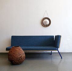 Here's a design is called Low Back Sofa sofa and was created by designer Liam Mooney. Here you can stretch up, relax and forget everything. Low Back sofa made of poplar, epoxy coated steel and woven fabric that looks like blue jeans. Sofa is available in blue or black. The sofa looks simple but very comfortable, will look great in a modern style of your living room or maybe in a library or study. Here you can stretch up, relax and forget everything.
