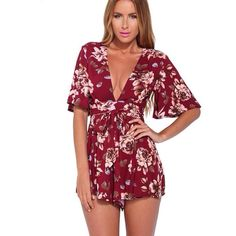 Floral print burgundy romper Size large brand new never worn Sabo Skirt Dresses