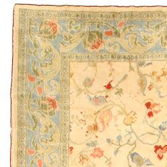 A second quarter 20th century Spanish rug, the creamy caramel field with…