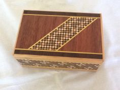 5 step, 7 sun Japanese puzzle box by Yoshiyuki Ninomiya 1985