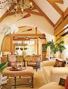High ceilings and fans with wide blades are commonplace in British Colonial decor. Their original purpose was to help keep the open and airy spaces cool. Notice the plantation chairs with their sloped backs and low seats. This design exemplifies West Indies style.