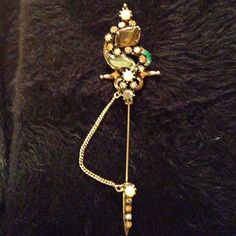 Vintage Florenza stick pin Mint condition Florenza stick pin. Has no noticeable wear.  Multi colored stones on a sword. Vintage Jewelry