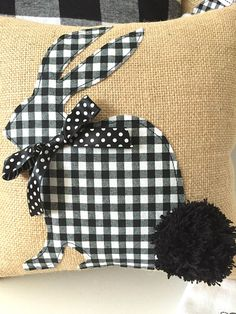This trendy check Bunny Pillow Cover is full of Easter goodness. With a big pom pom tail, this Easter Bunny Pillow Cover is sure to bring smiles and sweet love for the season. With its neutral color palette, it will easily blend in with the traditional pastels and be a gorgeous accent.