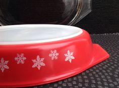 Rare Vintage Pyrex Red Gaiety Snowflake Divided Dish With Original Glass Lid.In Very Good Condition. by Onmykitchentable on Etsy https://www.etsy.com/listing/220799863/rare-vintage-pyrex-red-gaiety-snowflake