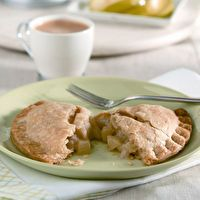 SPLENDA Baked Apple Turnovers: 4 Granny Smith apples-peeled and chopped, 1/3 cup water, 1/4 cup SPLENDA, 2 TBS all-purpose flour, 1/4 tsp ground cinnamon, 1 (15 oz) container refrigerated pie crusts, 1 egg white-lightly beaten