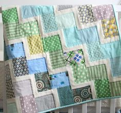 It's the quilting that makes the rails pop - see the single straight line to the left and the double straight line to the right of each rail?