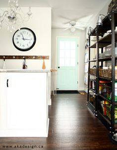 Love the colors in this updated kitchen- the neutral walls (Benjamin Moore white heron) and the minty green door