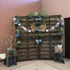 DIY Rustic floral photo backdrop for my brother & sister-in-laws baby shower :)... If anyone is interested, I still have the pallets available for rent!  PM me!