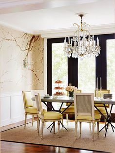Stunning #diningroom | wainscoting and neutral color scheme play off the black window frames