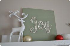 Use thumbtacks in canvas to make holiday sign