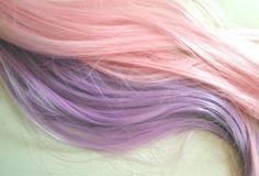 Light pink and purple strands of hair.