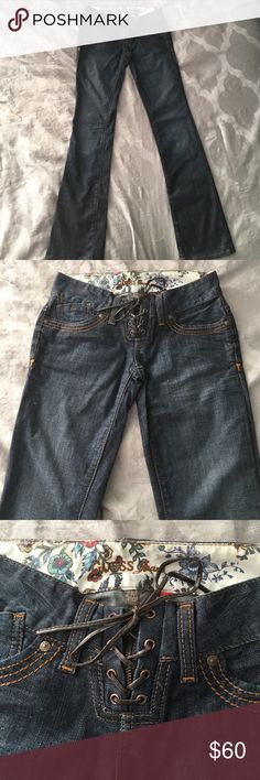 Guess jeans Extra low rise jeans. Lace up front. 5 pocket.  Boot cut Guess Jeans Boot Cut