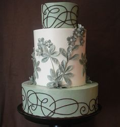 Elegant Grey & White Cake with Flowers and Swirls