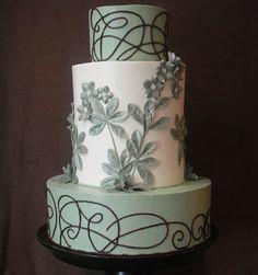 Elegant Grey & White Cake with Flowers and Swirls