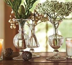 Decor Inspiration Holiday Decorating by Pottery Barn | DigsDigs - simplicity, pressed glass vases filled with greenery and white berries