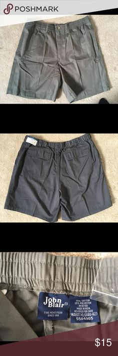 """Men's John Blair Olive colored shorts """"New"""" """"New,"""" John Blair men's shorts olive colored.  Two front side pockets, and one button up back pocket.  Elastic completely around the waist with zipper and button closure in front. 21"""" L measured from top of waist to bottom of the short.  Make an Offer John Blair Shorts"""