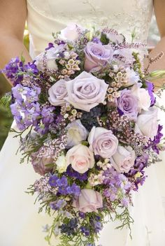 This one has Purple, lilac and pale pink roses, aster, lysianthus.not sure what the purple flowers with yellow centres are. But I would do the exact same think just not pale pink roses maybe try pale purple roses instead Bridal Flowers, Flower Bouquet Wedding, Silk Flowers, Flower Bouquets, Lavender Bouquet, Purple Bouquets, Lavender Roses, Cascade Bouquet, Diy Flower