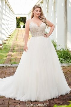 Payton Martin Thornburg Plus Size Wedding Dress, sleeveless lace tulle ball gown featuring spaghetti straps, V-neckline, an open back, and a chapel train. Plus Size Bridal Dresses, Plus Size Wedding Gowns, Wedding Dresses With Straps, Dream Wedding Dresses, Designer Wedding Dresses, Tulle Wedding Skirt, Tulle Ball Gown, Ball Gowns, Disney Inspired Wedding Dresses
