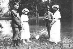A Solider, Grand Duchess Anastasia Romanov, Pierre Gillard, and Grand Duchess Olga Romanov