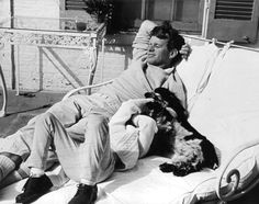 Bobby Kennedy relaxing with one of his children, and dog Freckles. Photographer: ?