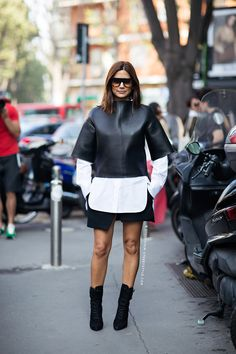 Christine Centenera in a Bassike top and shirt, Balenciaga skirt, Balmain boots and Celine sunglasses.