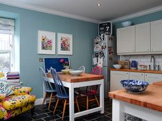 "Fiona Douglas/Bluebellgray. Our kitchen walls are painted in ""Dix Blue"" by Farrow & Ball. The kitchen units and floor were put in by the previous owners; I love the slate floor. Tthe blackboard is painted with blue blackboard paint — it makes me so much happier than a black one."