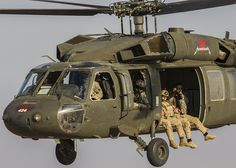U.S. 5TH FLEET AREA OF RESPONSIBILITY (Sept. 5, 2013) - A U.S. Army photographer captures imagery of U.S. Marines assigned to Force Reconnaissance Platoon, Maritime Raid Force, 26th Marine Expeditionary Unit (MEU), conducting parachute operations from UH-60 Black Hawk helicopters from Alpha Company, 1-189th General Support Aviation Battalion (GSAB), Montana Army National Guard. (U.S. Marine Corps photo by Sgt. Christopher Q. Stone, 26th MEU Combat Camera/Released)